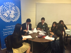Burnaby students collaborating to draft a group resolution, meant to offer strategies to implement the UN Sustainable Development Goals.